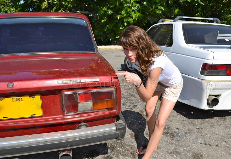 Download Nice young girl at a car stock photo. Image of shirt - 23155080