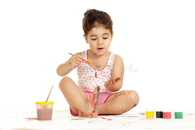 Nice young girl painting picture on white background stock photos