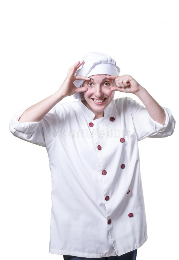 Nice young woman chef is looking something stock photos