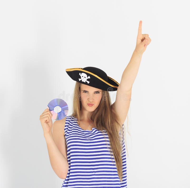 Nice young woman with pirate cd or dvd disk royalty free stock photos