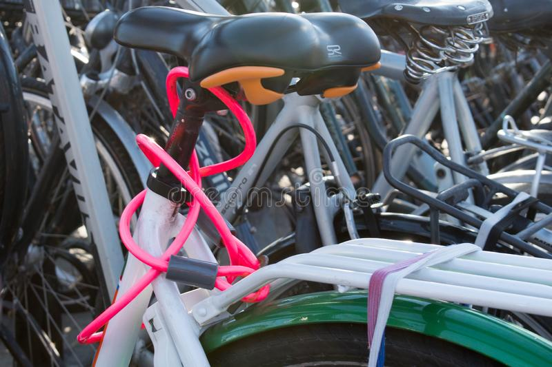 A nicely coloured pink bicycle lock royalty free stock images