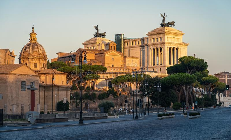 Nicely lit panorama of Rome. Victor Emmanuel II National Monument in Rome during sunrise in golden hour. Nicely lit panorama of Rome. Victor Emmanuel II National royalty free stock image