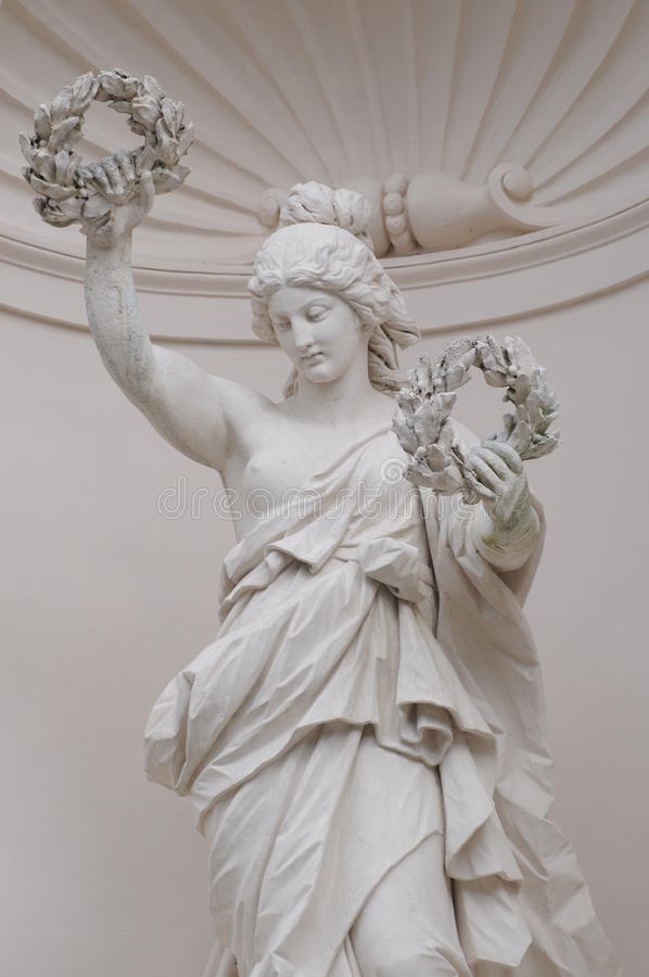 Niche Figure Victoria At Linderhof Palace. This beautiful niche figure called Victoria can be found at the main fassade of Linderhof palace, located in Germany stock photos