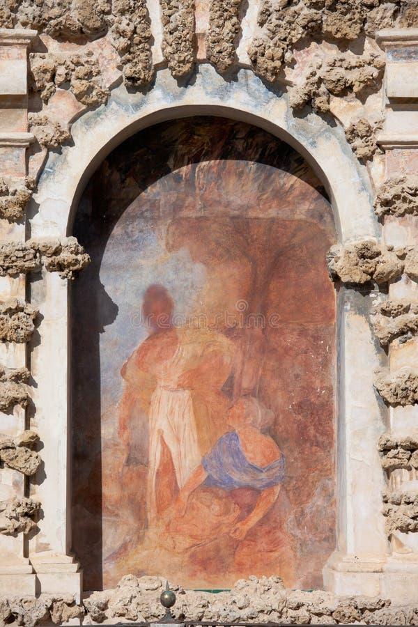 Niche Fresco in Real Alcazar of Seville. Old niche fresco of the Grotesque Gallery (Galeria del Grutesco) in Real Alcazar Garden of the Pond (Jardin del Estanque stock image
