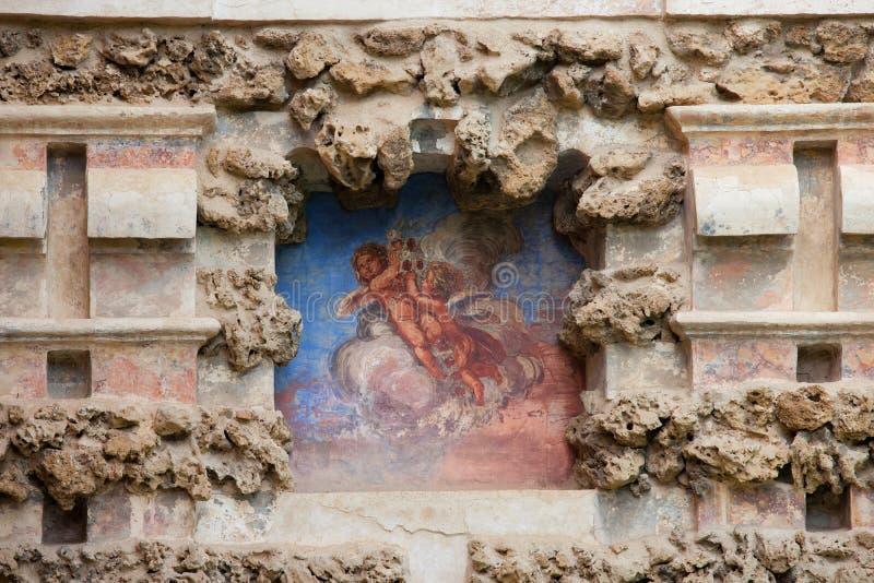 Niche Fresco in Real Alcazar of Seville. Cherubs on an old niche fresco of the Grotesque Gallery (Galeria del Grutesco) in Real Alcazar Garden of the Pond ( stock photos