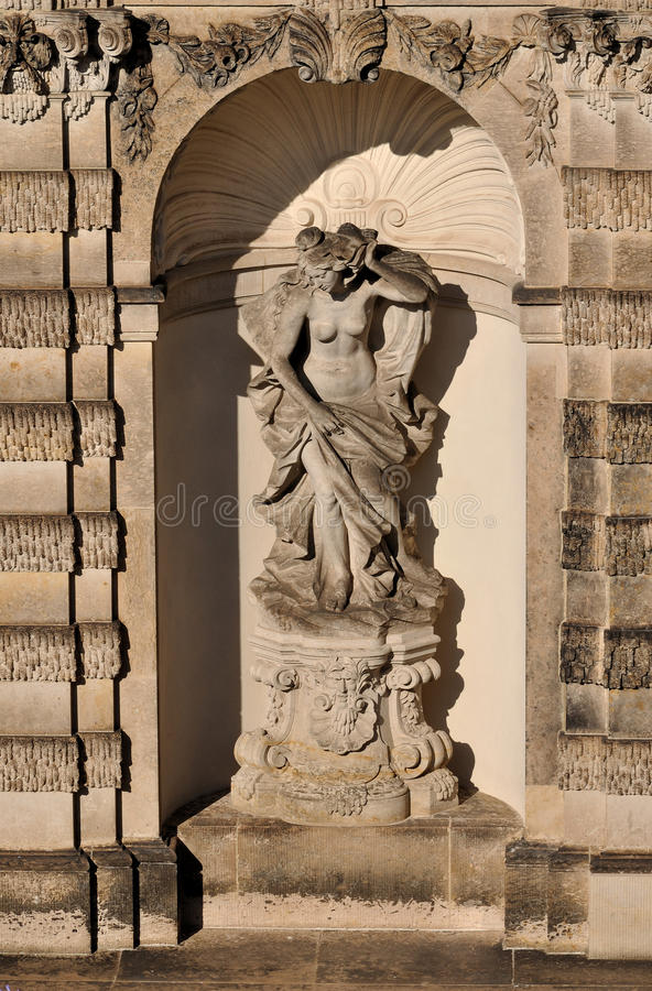 Niche at zwinger, dresden. Sunny niche with statue of a nymph at a famous baroque palace and museum in dresden, the building has been rebuilt after second world stock image