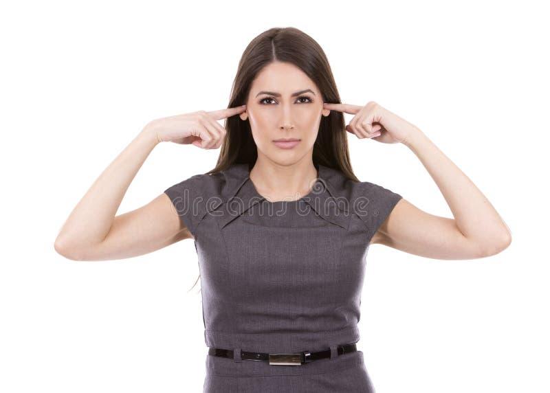 Nicht hörende Geschäftsfrau stockfotos