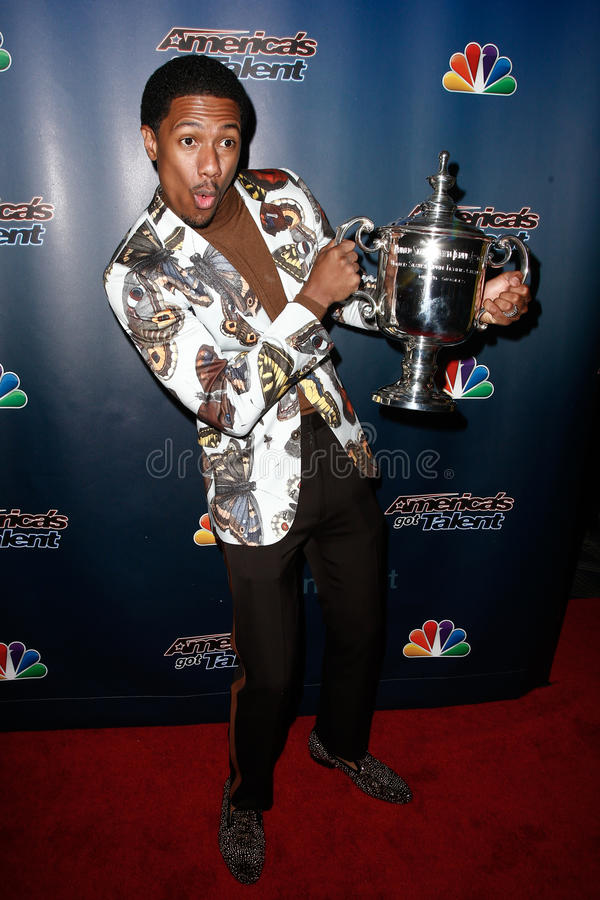 Nick Cannon. NEW YORK-AUG 6: TV host Nick Cannon holds the US Open Tennis trophy at the 'America's Got Talent' post show red carpet at Radio City Music Hall on stock photography