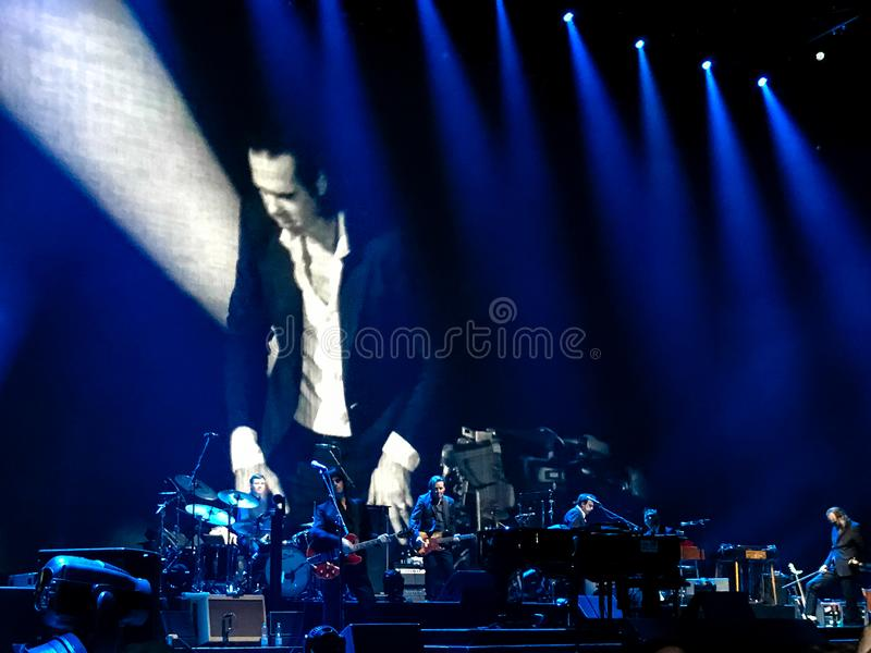 Nick Cave And The Bad Seeds. Great it was, the concert. He is a Mephisto, priest and Elvis at the same time, both a master of dark romance and poetic noble royalty free stock photo