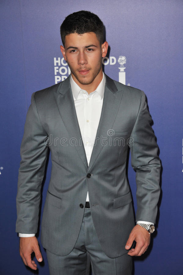 Nick Jonas. BEVERLY HILLS, CA - AUGUST 14, 2014: Musician Nick Jonas, of The Jonas Brothers, at the Hollywood Foreign Press Association's annual Grants Banquet royalty free stock photo