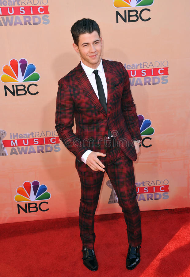 Nick Jonas. LOS ANGELES, CA - MARCH 29, 2015: Nick Jonas at the 2015 iHeart Radio Music Awards at the Shrine Auditorium royalty free stock image
