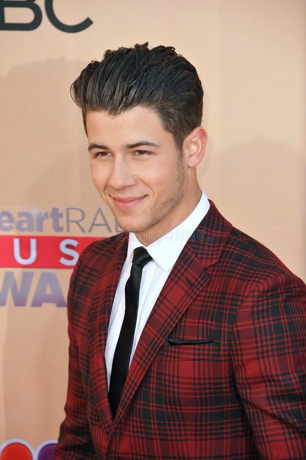 Nick Jonas. LOS ANGELES, CA - MARCH 29, 2015: Nick Jonas at the 2015 iHeart Radio Music Awards at the Shrine Auditorium royalty free stock images