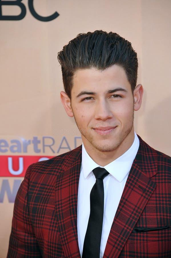 Nick Jonas. LOS ANGELES, CA - MARCH 29, 2015: Nick Jonas at the 2015 iHeart Radio Music Awards at the Shrine Auditorium stock photo
