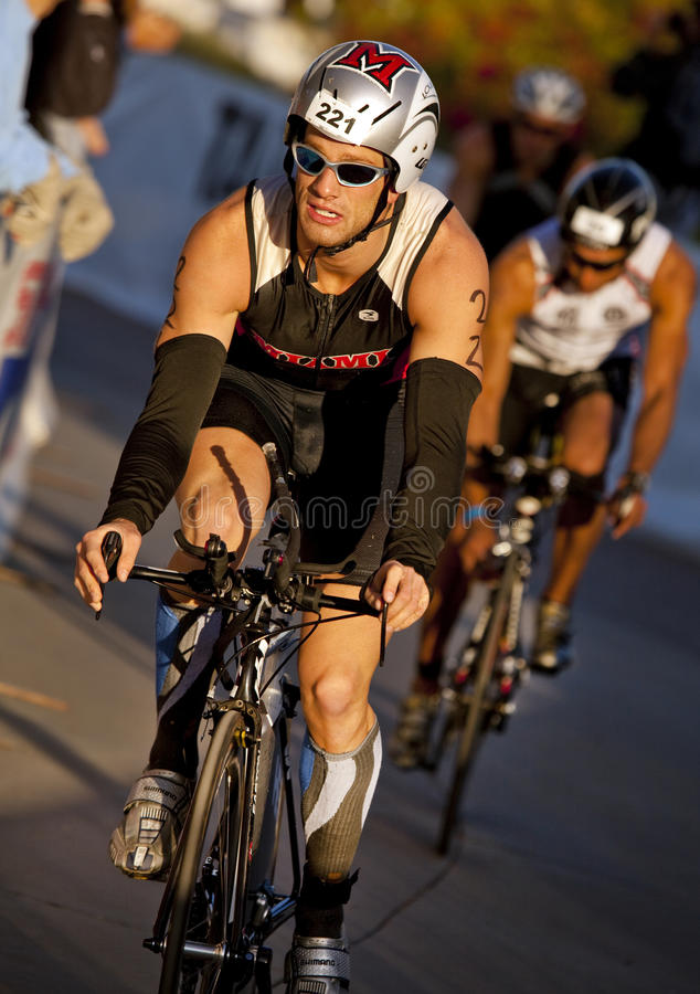 Nick Stanoszek Racing in the Arizona Ironman Triat. TEMPE, AZ - NOV. 22: Nick Stanoszek in the cycling stage of the Phoenix Ironman Triathlon on November 22 royalty free stock photos