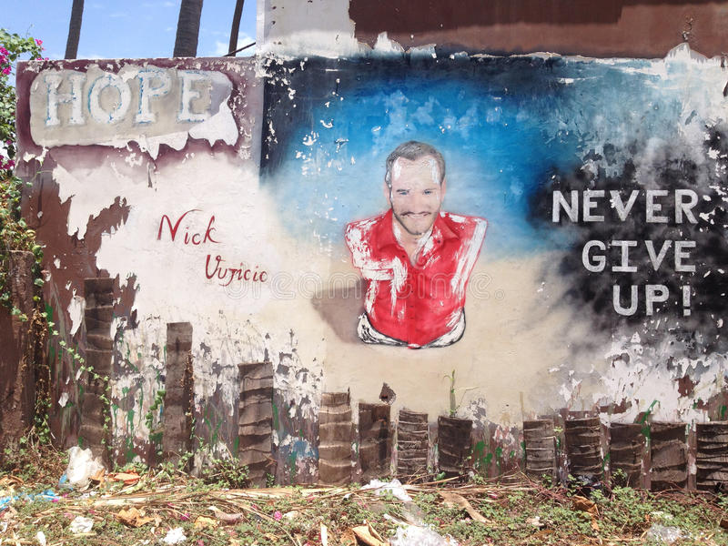 Nick Vujicic - Never give up!. Nick Vujicic is a famous survivor, and its graffiti is dedicated to him stock image