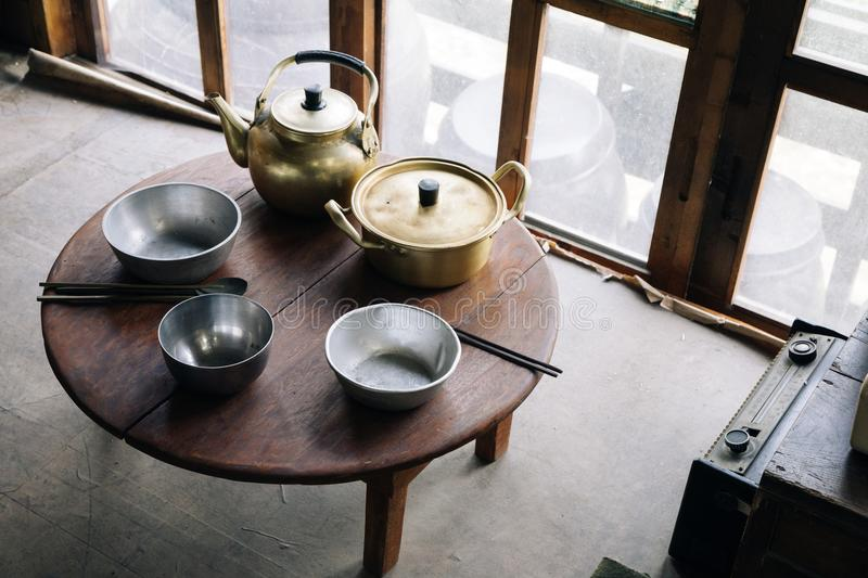 Nickel-silver pots on the table in Korean old house royalty free stock photos