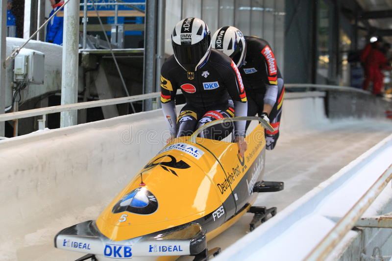 Nico Walther - bobsleigh. Nico Walther and Christian Poser from Germany in the world cup race in bobsleigh held in Altenberg on 28.11.2015 stock images
