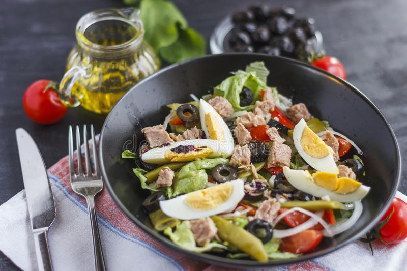 Nicoise salad with tuna, green beans, basil and fresh vegetables royalty free stock photos