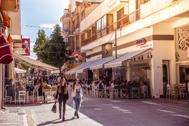 NICOSIA - APRIL 13 : People walking on Ledra street on April 13, 2015 in Nicosia, Cyprus. It is is a major shopping thoroughfare royalty free stock photo