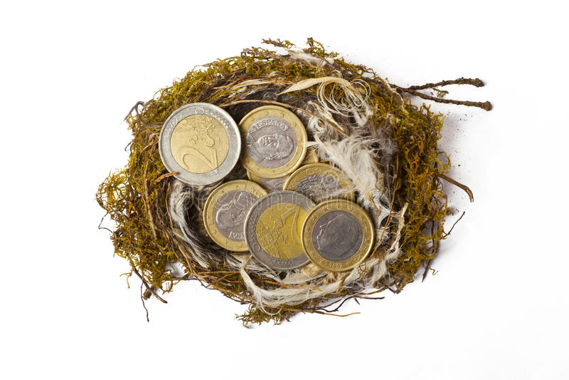 Nid avec d'euro pièces de monnaie photographie stock
