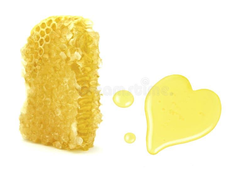 Nid d'abeilles et baisses avec la forme de coeur photo stock