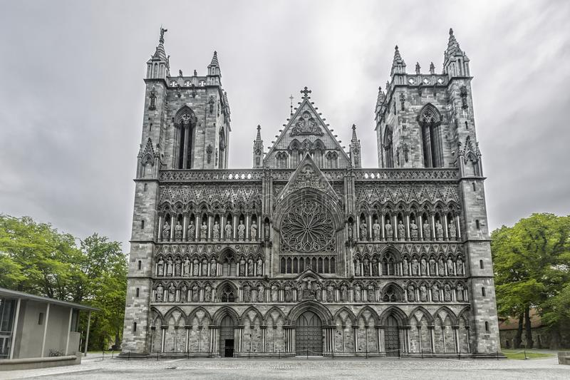 Nidaros Cathedral in Trondheim, Norway. Nidaros Cathedral (Norwegian: Nidarosdomen / Nidaros Domkirke) is a Church located in Trondheim, Norway. Built over the stock image