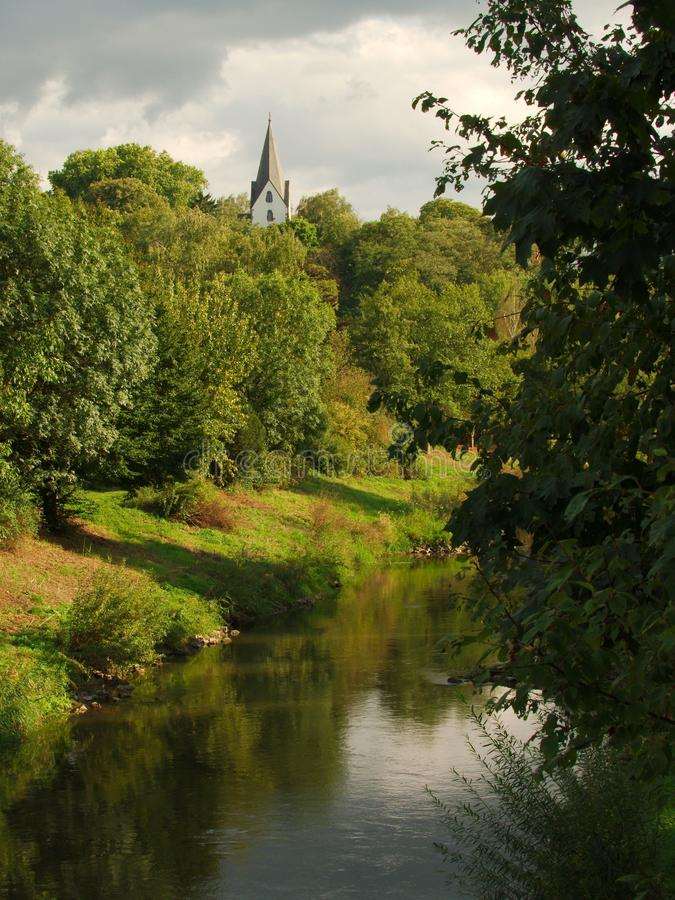 Nidda and Auferstehungskirche of Bad Vilbel, Germany. View on the river Nidda and the oldest church Auferstehungskirche of Bad Vilbel, Germany royalty free stock photos