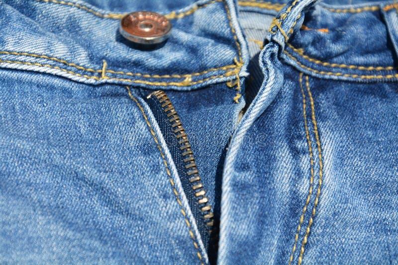 Niebiescy dżinsy i suwaczka tło fotografia stock
