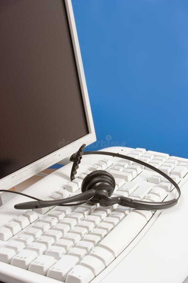 niebieska komputerowa klawiatura słuchawki zdjęcia stock