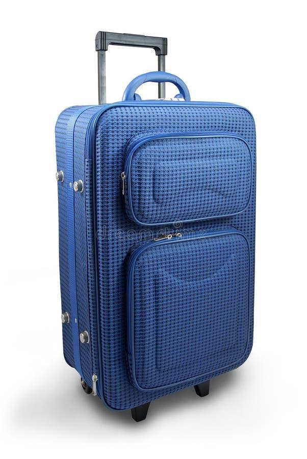 niebieska walizka podróż. fotografia stock