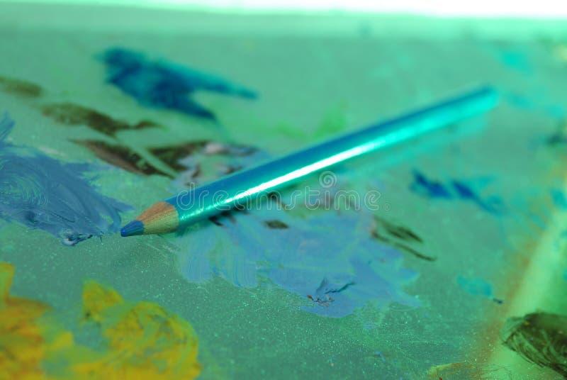 niebieski artysty ołówek obrazy stock