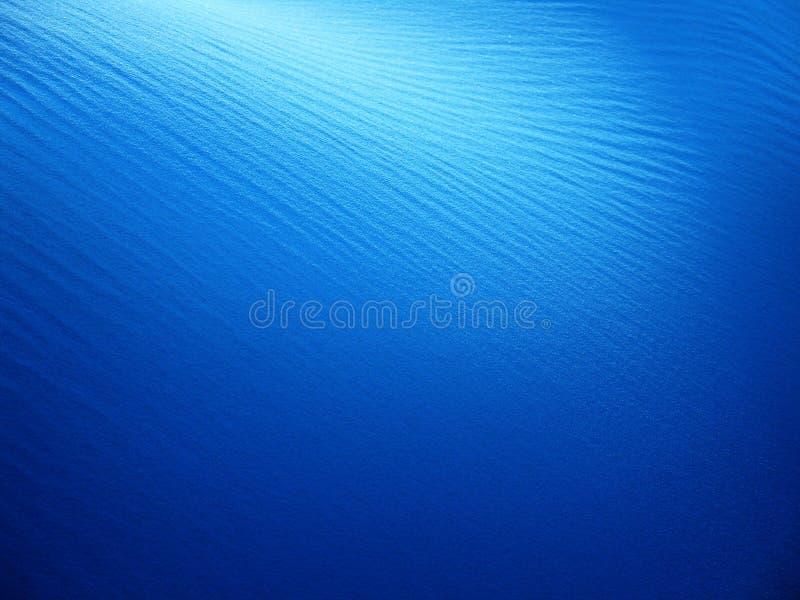 niebieski tła piasku zdjęcie stock
