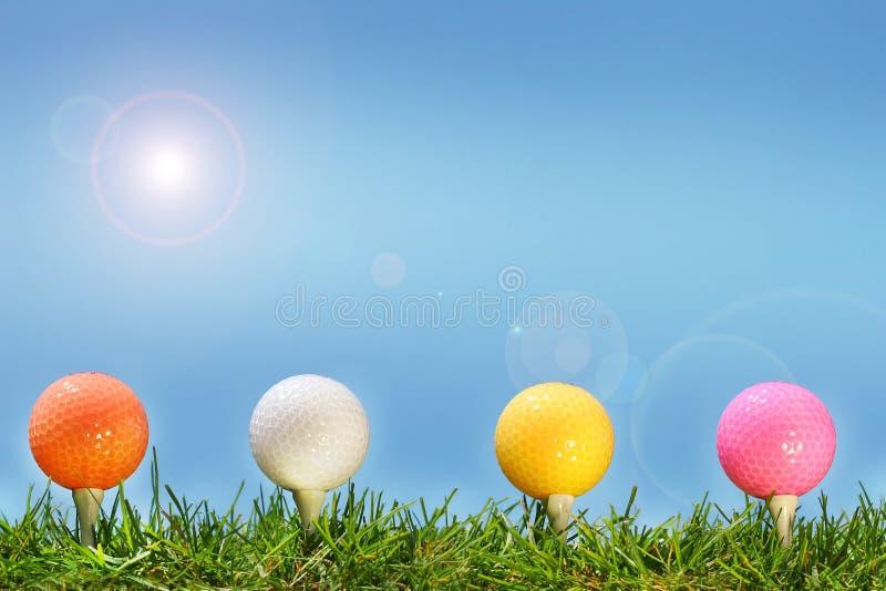 niebieskie oczy, piaskowe piłki golfowe gras obrazy stock