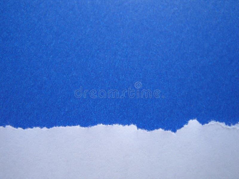 niebieskie tło księgi rozdarty zdjęcie stock