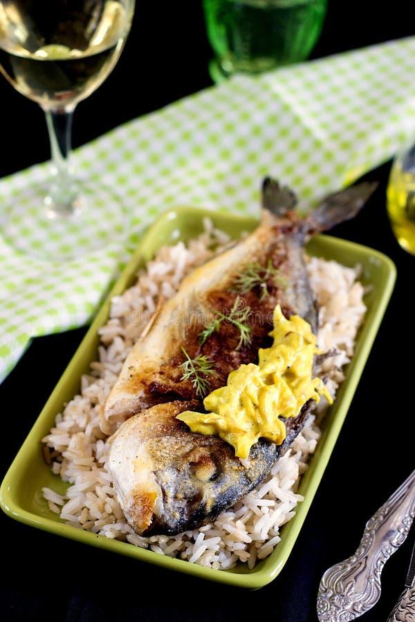 Niecka smażył głowa leszcza z ryżowym i cebulkowym kumberlandem fotografia royalty free