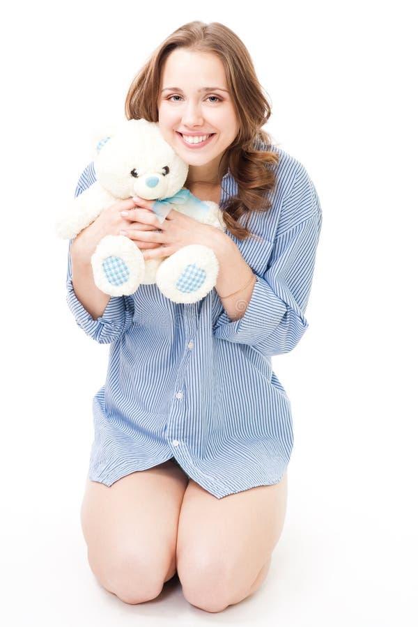 niedźwiadkowa chwyta uśmiechu miś pluszowy kobieta obrazy stock