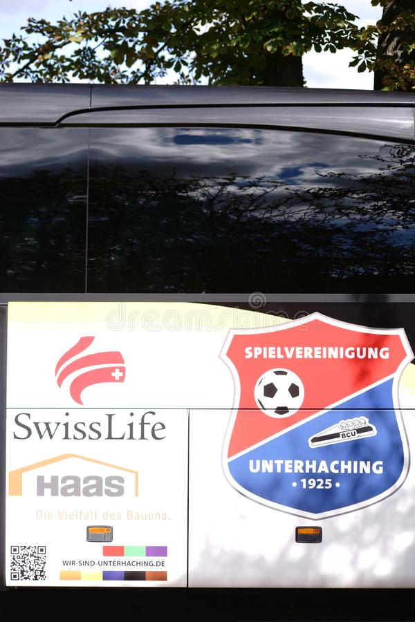 Team bus Spielvereinigung Unterhaching. Nieder-Olm, Germany - September 15, 2018: The coat of arms of the football club Spielvereinigung Unterhaching on the team royalty free stock photos