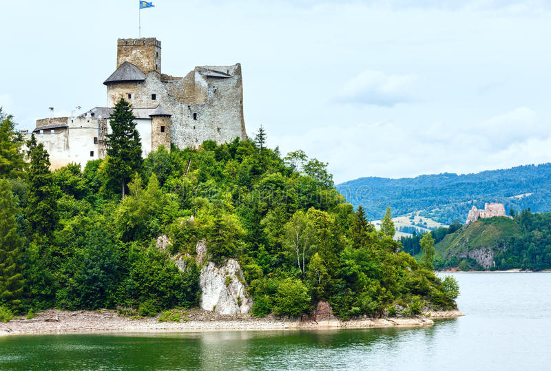Niedzica Castle (or Dunajec Castle) summer view (Poland). Niedzica Castle (or Dunajec Castle) summer cloudy view (Poland). Build between the years 1320 and 1326 royalty free stock photos