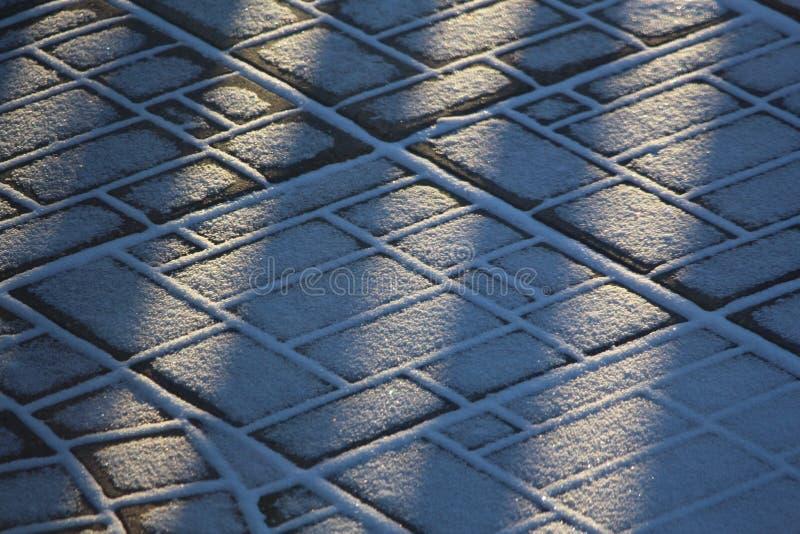 Download Śnieg Tekstury Na Brukowych Kamieniach I Wzory Obraz Stock - Obraz złożonej z kamienie, nieg: 106919943