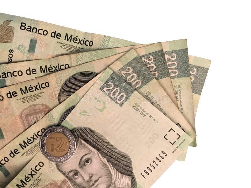 Niektóre meksykańskiego peso 200 papierowi rachunki grupujący i na białym tle fotografia royalty free