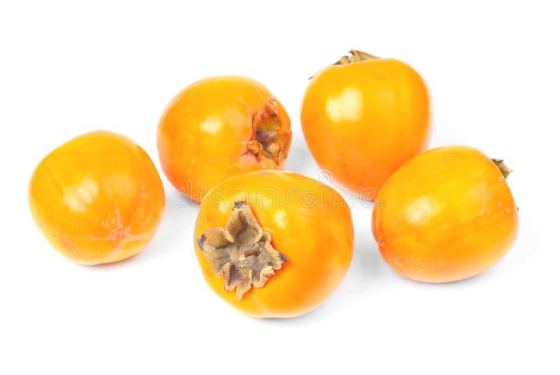 Niektóre persimmon owocowy plasterek na białym tle zdjęcie stock