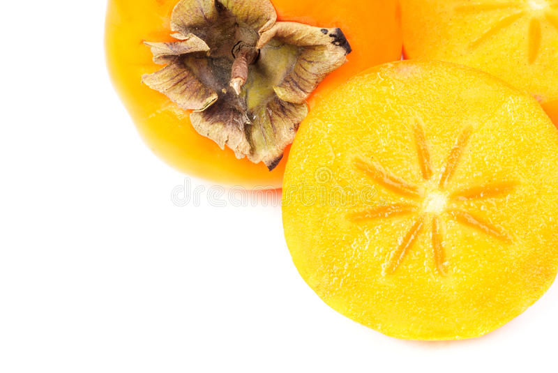 Niektóre persimmon owocowy plasterek na białym tle obraz royalty free