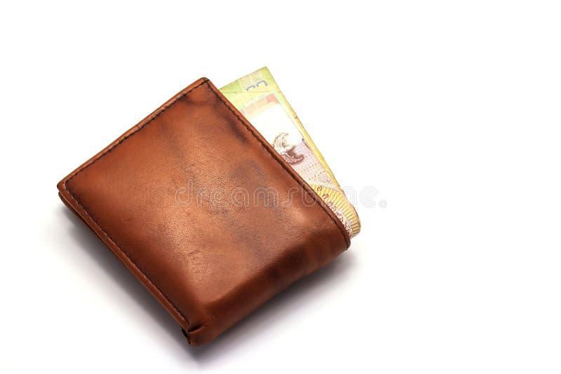 Niektóre pieniądze w brown portflu obraz stock