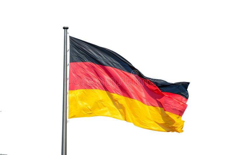 Niemiec chorągwiany falowanie na srebnym flagpole Biały tło, zakończenie w górę, przestrzeń zdjęcia royalty free