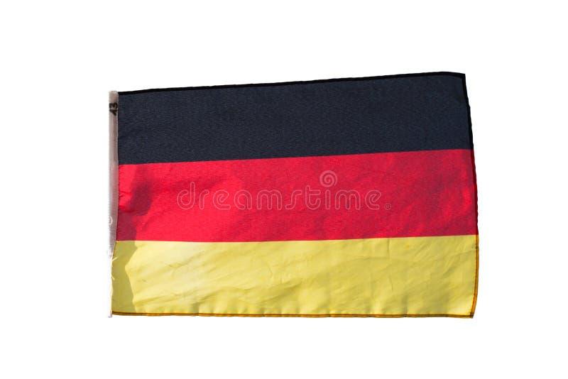 Niemiec flaga w białym tle dalej zdjęcia stock