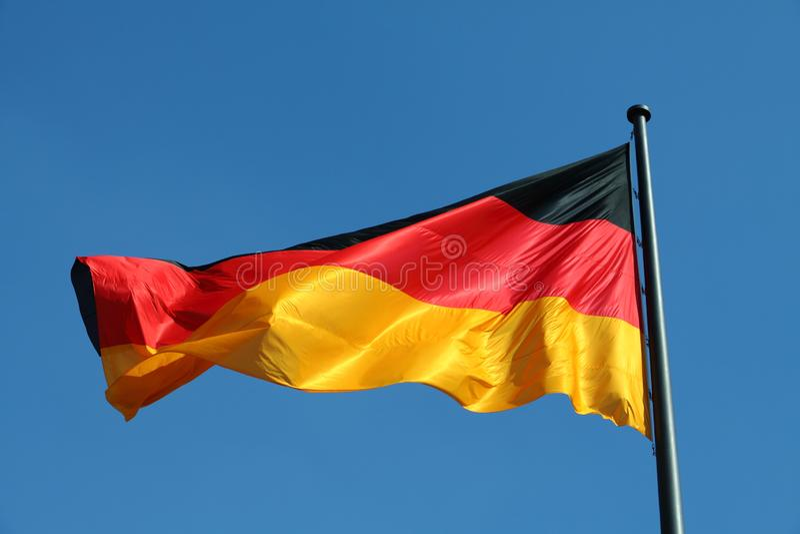 Niemiec flaga w wiatrze obrazy stock