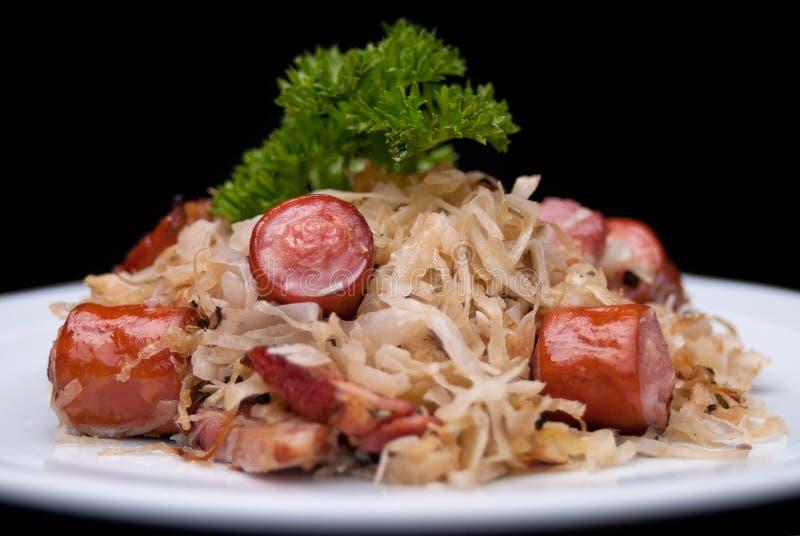 Niemiec, połysk, Austriacki kuchni naczynie, Bigos - kapusta stewed z mięsem i kiełbasami obrazy stock