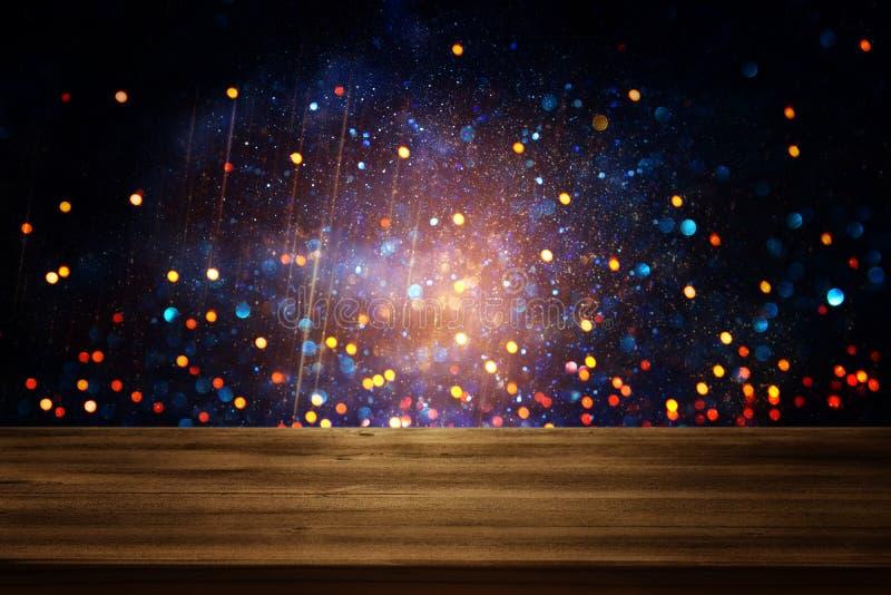 nieociosany drewno stół przed błyskotliwości czernią, błękitem i złocistymi jaskrawymi bokeh światłami, ilustracji