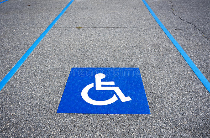 Niepełnosprawny symbol obezwładniający parking znak obrazy royalty free