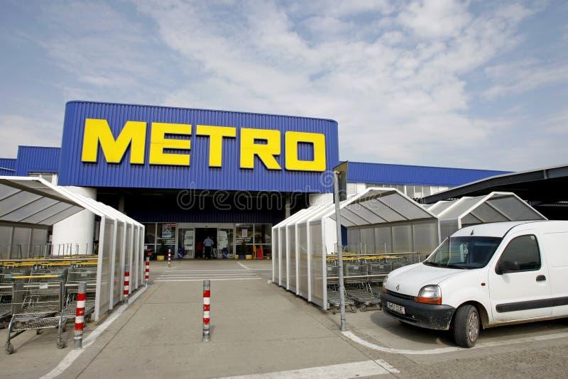 niesie gotówkowego loga metra supermarket zdjęcia royalty free